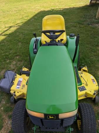 Photo John Deere GT235 garden tractor with 54 inch cut - $1,600 (Jackson)
