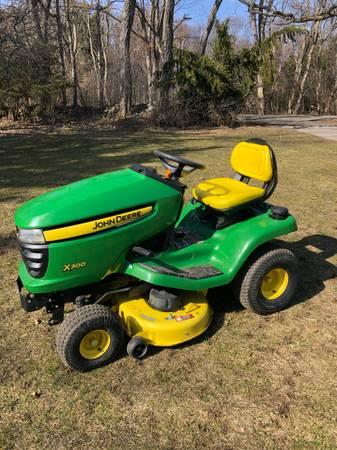 Photo John Deere X300 Lawn Tractor  Riding Lawn Mower - $1,400 (Jackson, MI)