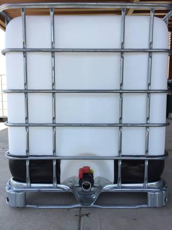Photo 275 Gallon Tanks, IBC Food Grade Totes, Water Storage. FREE DELIVERY - $75 (Pleasant Hill, MO)