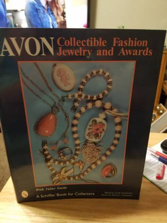 Photo Avon collectible fashion jewelry and awards with value Guide book - $30 (Kansas City)