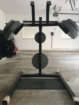 Photo Gym equipment,100lb. boxing bag and gloves. (Excelsior Springs)