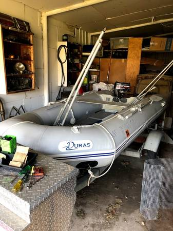 Photo Inflatable boat, motor and trailer - $1,400 (smithville)
