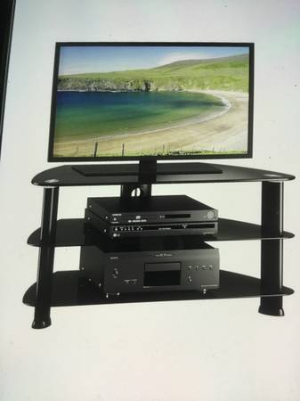 Photo Tv corner stand - $100 (Anchorage)