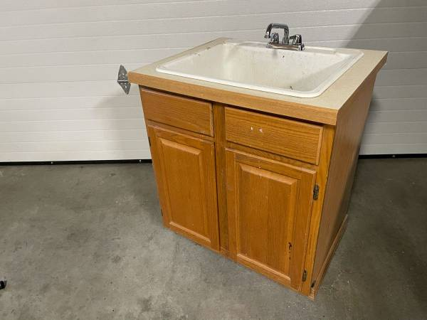 Photo Utility sink, cabinet, and new faucet - $25 (Sand Lake - Anchorage)