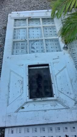 Photo Front  Exterior Door 9 lights with Doggy Door - $25 (Big Pine Key)