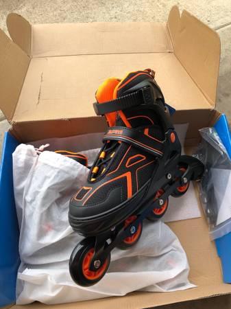 Photo Roller blades size 4-7 adjustable - $40 (Roseburg)