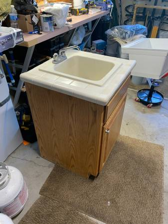 Photo Utility sink vanity with faucet - $30