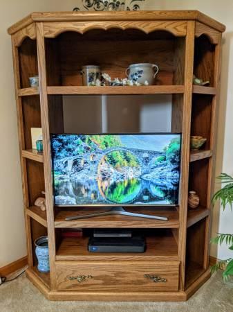 Photo Oak Corner TV Stand - $65 (Black River Falls, WI)