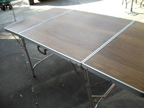 Photo Expandable folding table - $50 (Lafayette, La.)