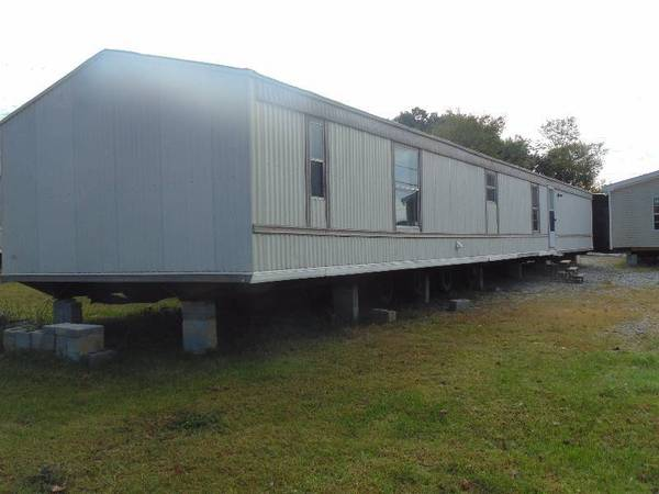 Photo Sell your used singlewide and doublewide mobile home - $1 (Lake Charles Sulphur Moss Bluff Iowa)