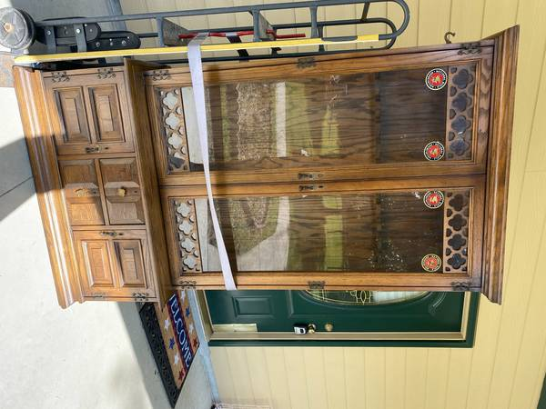 Photo oak and glass gun cabinet - $150 (Ft White)