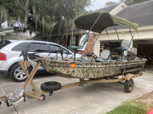 Photo 1977 14ft Polar Kraft Jon boat, 1984 35 HP Johnson, and trailer - $2,500 (Winter Haven)