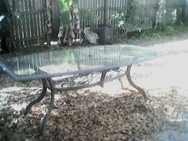 Photo Aluminum glass top patio table - $35 (Plant city)
