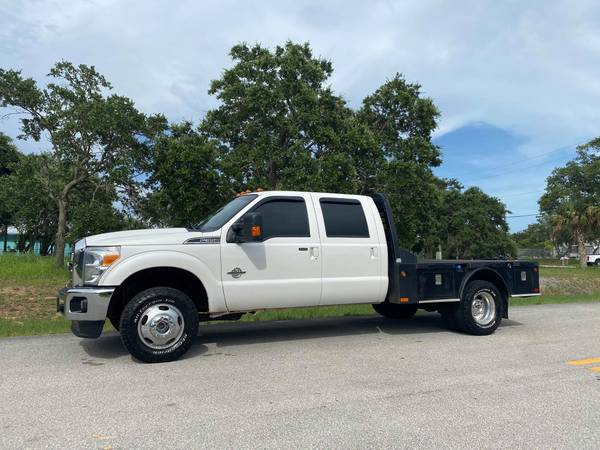 Photo SUPER CLEAN 2014 Ford F350 Lariat LOADED LEATHER FLATBED DUALLY FX4 - $31500 (DIESEL TRUCK SOURCE - We Sell Diesel Trucks)