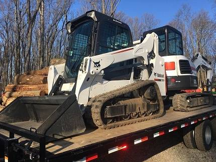 Photo Skid steer available. and E35 Mini Excavator Full Package - $26800