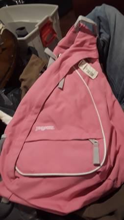 Photo Jansport sling shoulder cross body bag backpack ice skates blades - $25 (Holt)