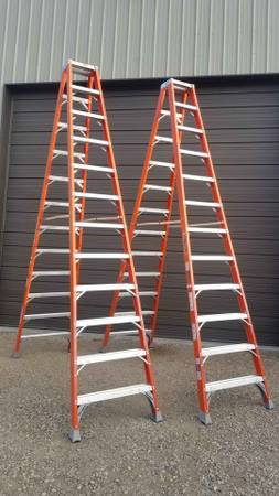 Photo $175 each Louisville 12 ft. 300lb double sided step ladder ladders - $175 (woodstock illinois)