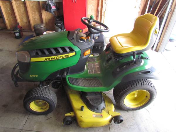 Photo 54quot John Deere riding Lawn mower - $1500 (leland)