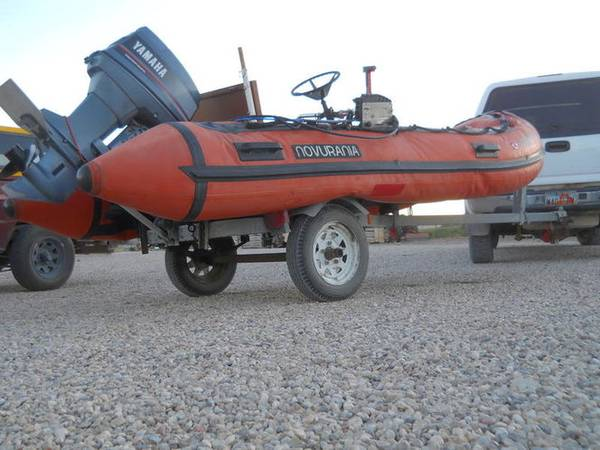 Photo 14 foot inflatable boat with 40hp motor with trailer - $3,000 (Central Utah)