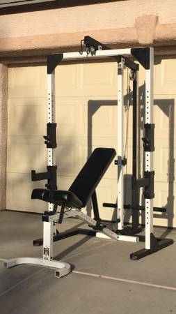 Photo Squat Rack with High Low Pulley and FID-M Dumbbell Weight Bench - $399
