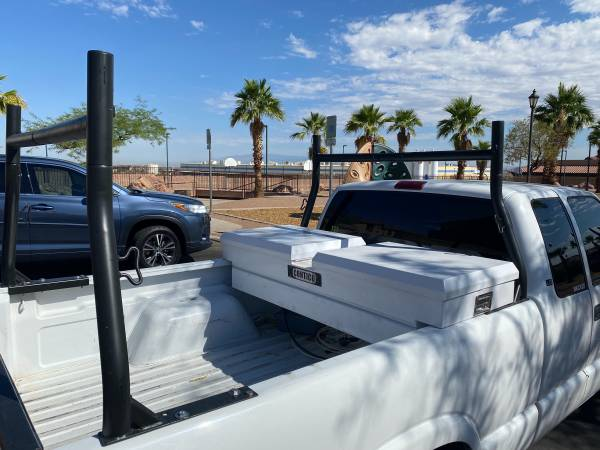 Photo Truck bed tool box and ladder rack - $250 (Henderson)