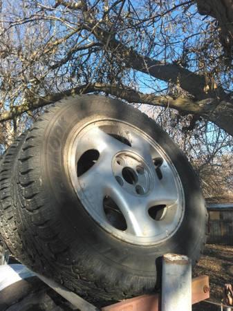 Photo 4 x 100 Honda rims and snow tires - $200 (Lewiston)