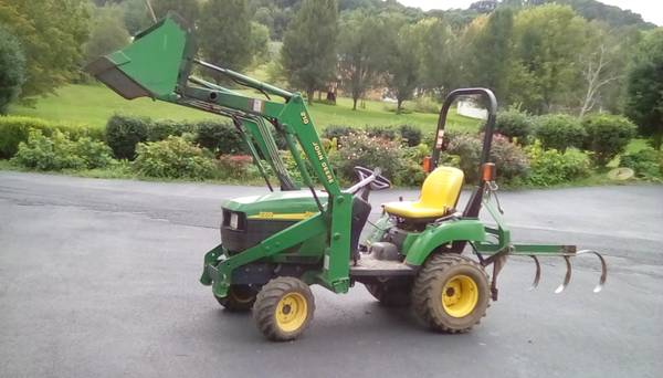 Photo 22 hp. John Deere 4wd. Tractor - $8,950 (6485 highway 1194)