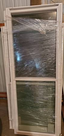 Photo 4 double hung white vinyl replacement windows - $50 (Winchester)