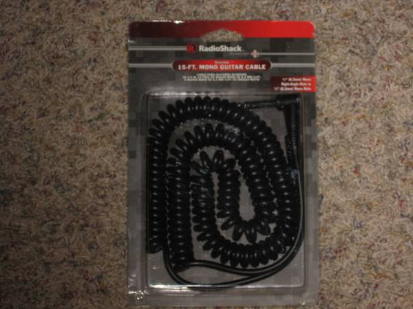 Photo Coiled 15ft Guitar Cable 14 inch quotNEWquot unopened package - $15 (West Toledo)