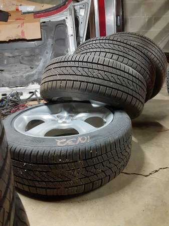 Photo 17 inch Continental PureContact tires and 2006 Subaru Legacy wheels - $600 (Lincoln)