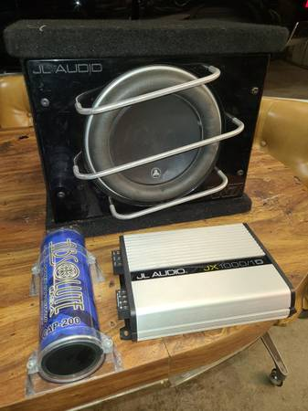 Photo JL audio 10quot w7 loaded in a wedge box  and cap - $500 (Lincoln.... havelock)