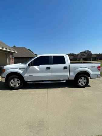 Photo Ford 2014 F-150 Supercab- 49,000 miles Rebuilt Title - $15,000 (Searcy, AR)