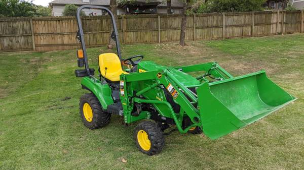 Photo John Deere 1023E with H120 quick attach loader - $11,500 (Sherwood)