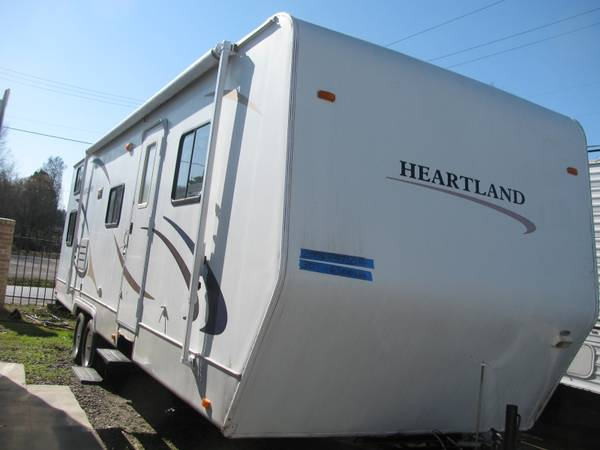 Photo SMITH CAMPERS-2006 HEARTLAND-BUNKHOUSE-QUEEN BED AND 2 BUNKS - $4990 (North Little Rock)