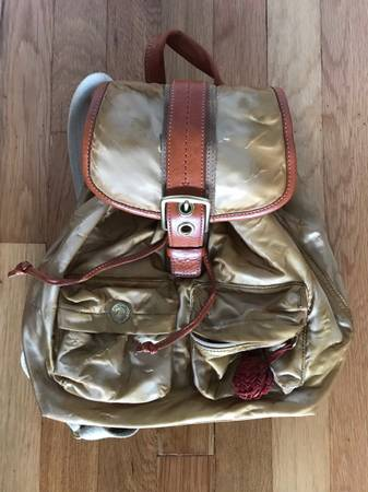 Photo Coach gold satin and leather backpack - $50 (Wantagh)