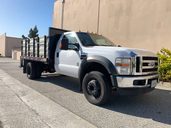 Photo Ford F-550 F550 12 Flatbed Stake Bed Contractors Utility Bed Flat Bed - $15900 (ONLY 28k MILES On Newer Engine - Long Beach)