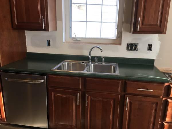 Photo Kitchen sink and countertop (ColumbiaMillersburg)