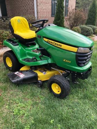Photo John Deere X300 lawn mower - $1800 (Rustburg, VA)
