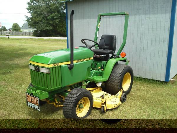 Photo 1993 John Deere 670 Tractor and Mower - $5,950 (Perry, GA)