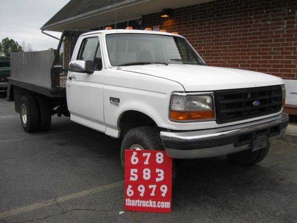 Photo 1996 FORD F350 4X4 DUALLY FLATBED FOUR WHEEL DRIVE - $8400 (Locust Grove)