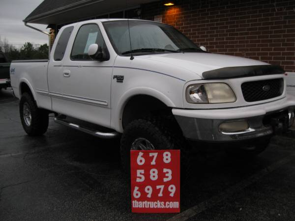Photo 1998 FORD F150 LARIAT EXTENDED CAB W  SUSPENSION LIFT AND 35,S - $4900 (LOCUST GROVE)