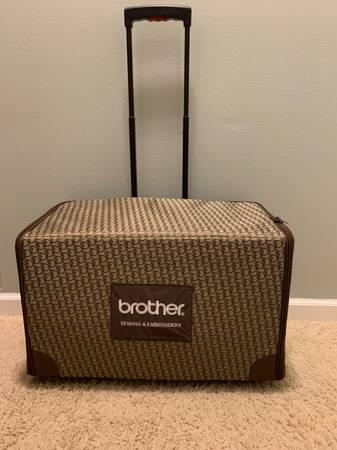 Photo Brother Sewing Machine Rolling Luggage - $75 (Windsor)
