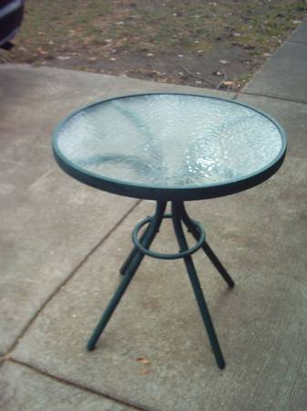 Photo Sturdy hunter green 24quot dia. glass top patio table. - $10 (Madison east side)