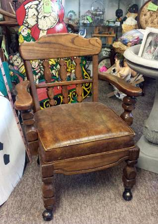 Photo SALE $19 wood chair with roller legs - $19 (St Peter MN downtown on hwy 169)