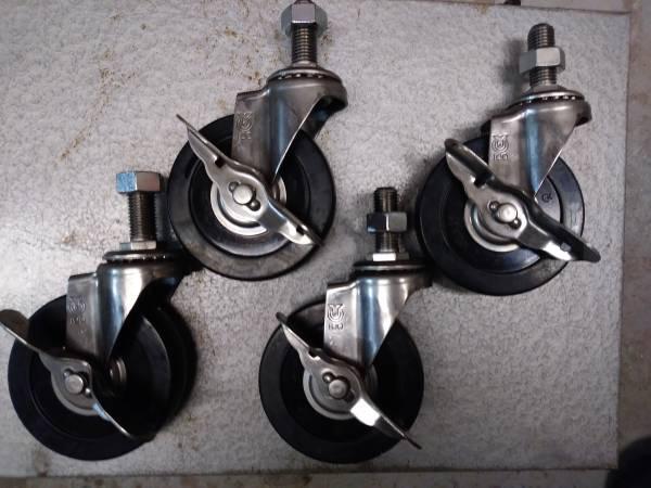 Photo Set of 4 swivel casters - heavy duty - all locking - $25 (MINNEAPOLIS)