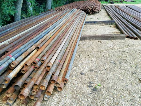 Photo used oil field pipe and sucker rod (Slayton, MN)