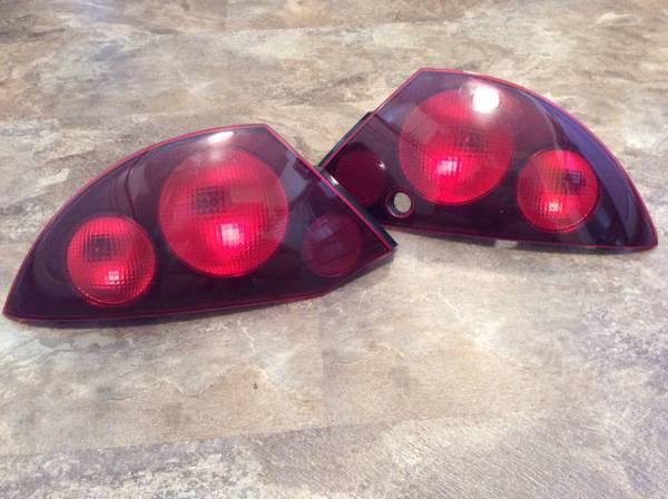 Photo 2000-02 Mitsubishi Eclipse Taillight Housings-2 driver and pass - $10 (Mason City, Iowa)