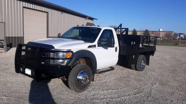Photo 2012 Ford F550 4x4 12ft Flatbed 114k 3yr Engine Warranty F-550 - $29,500 (n w i o wa)