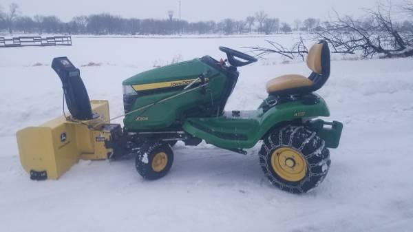 Photo John Deere X304 All Wheel Steer Riding Lawn Mower and Snowblower (Lake View)