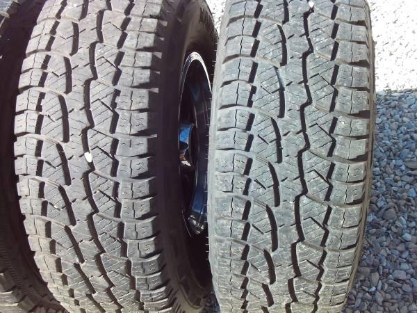 5 31x10.50-15s on 5 ford wagon wheels very good tread  tach dash - $450 (indy south side)